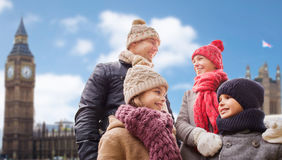 Happy family over london city background. Family, travel, tourism, winter holidays and people concept - happy parents with kids over london city background Stock Photo