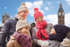 Happy family over london city background. Family, travel, tourism, winter holidays and people concept - happy parents with kids over london city background Royalty Free Stock Image