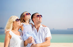 Happy family  over summer beach background Stock Photo