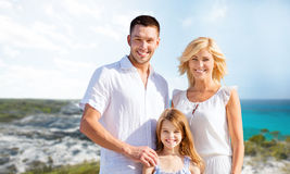 Happy family over summer beach background Stock Photos