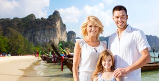 Happy family over thailand or bali beach Royalty Free Stock Photo