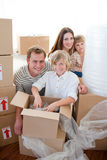 Happy family packing boxes during a removal Royalty Free Stock Images