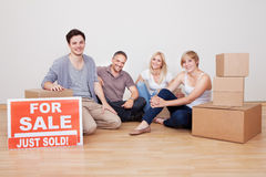 Happy family packing up their home Stock Photography