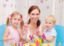 Happy family painted Easter eggs Royalty Free Stock Photography