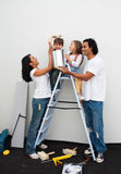 Happy family painting a room Stock Images