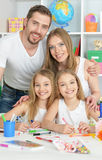 Happy family painting together Stock Image