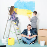 Happy family painting wall Stock Image