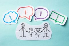 Happy family. Happy paper family with speech bubbles of Success concept on the blue background Stock Photos