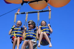 Happy Family Parasailing Royalty Free Stock Image
