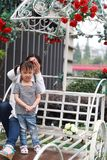 Happy family parental activity mother daughter hand in hand play and have fun outdoor in summer park child parent love girl. In sunny summer day, partents play royalty free stock images