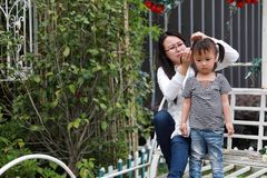 Happy family parental activity mother daughter hand in hand play and have fun outdoor in summer park child parent love girl. In sunny summer day, partents play stock photo