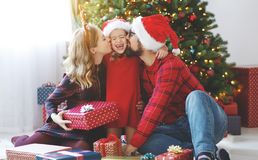 Happy family open presents on Christmas morning stock photo