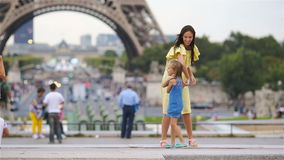 Happy family in Paris near Eiffel tower. Mother and kids enjoy time on their french holiday in warm summer day stock video footage