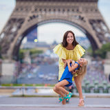 Happy family in Paris near Eiffel Tower during Stock Photography