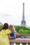 Happy family in Paris near Eiffel Tower during summer french vacation Stock Images
