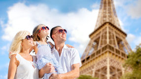 Happy family in paris over eiffel tower background Stock Image
