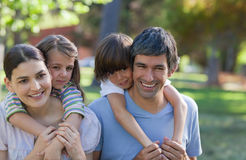 Happy family in the park royalty free stock photo
