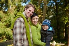 Happy family in park Stock Photo