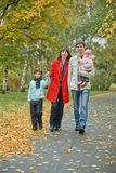 Happy Family In Park Stock Photo