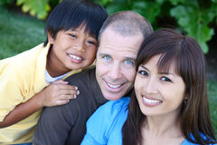 Happy Family in the Park Stock Photos