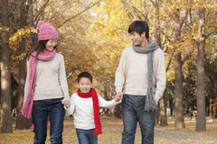 Happy Family in the Park in Autumn Stock Images