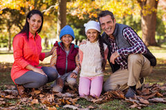 Happy family at park during autumn Stock Photo