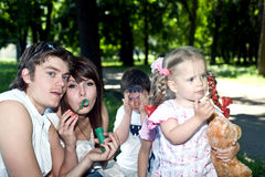 Happy family in park with  bubbles. Royalty Free Stock Photos