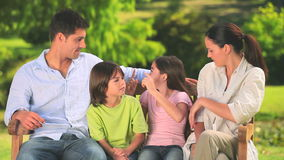 Happy family in a park stock footage