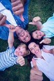 Happy family in the park gesturing thumbs up Royalty Free Stock Photos