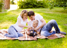 Happy family in park Royalty Free Stock Image
