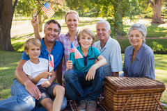 Happy family in the park and holding american flag Stock Image