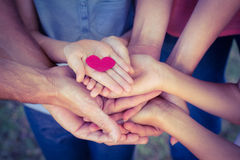 Happy family in the park holding a heart Stock Photography