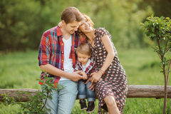 Happy family in a park stock image