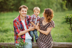 Happy family in a park Royalty Free Stock Photos