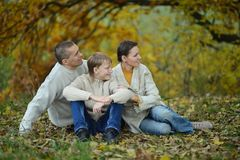 Happy family in park sitting Royalty Free Stock Images