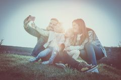 Happy family in the park. Happy family smiling while taking self royalty free stock photography