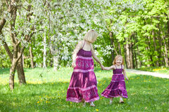 Happy family in the park. In spring season royalty free stock photo