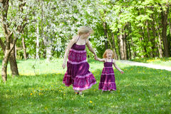Happy family in the park. In spring season stock photography