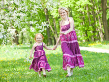 Happy family in the park. In spring season stock image
