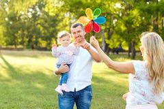 Happy family in a park in summer autumn. stock photo