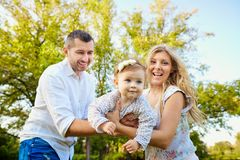 Happy family in a park in summer autumn. stock photography