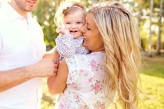 Happy family in a park in summer. royalty free stock photography