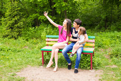 Happy family in the park taking selfie on a sunny day Royalty Free Stock Images
