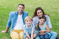 Happy family in the park together Stock Images