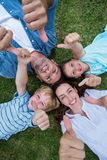Happy family in the park together thumbs up Royalty Free Stock Photography