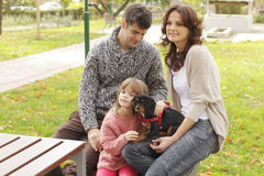 Happy family in the park Stock Photos