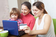 Happy family  paying by credit card in internet store Royalty Free Stock Image