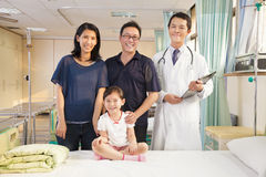 Happy family and pediatrician standing in the ward Royalty Free Stock Photos