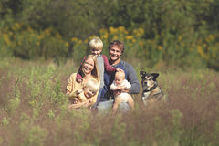 Happy Family of 5 People and Dog in Sunny Garden Royalty Free Stock Photos