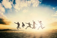 Happy family people group celebrate jump for good life on weekend concept for win victory, person faith in financial freedom healt